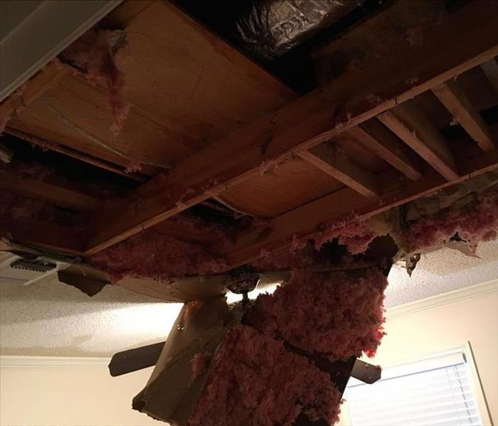 Damge from busted water heater located in the attic